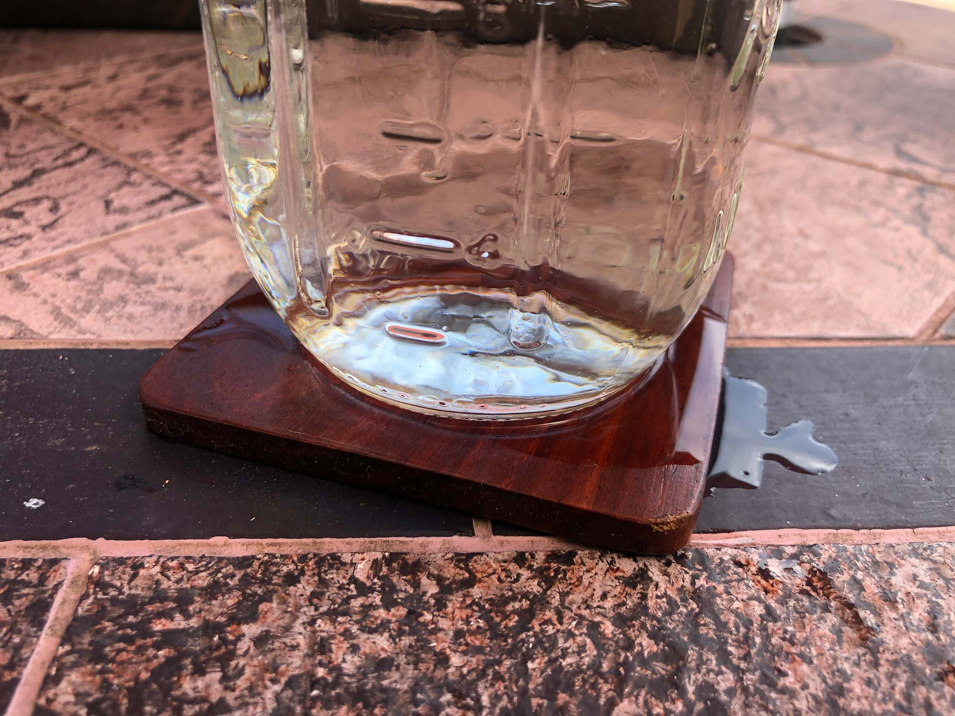 Non absorbent coaster spilling onto furniture